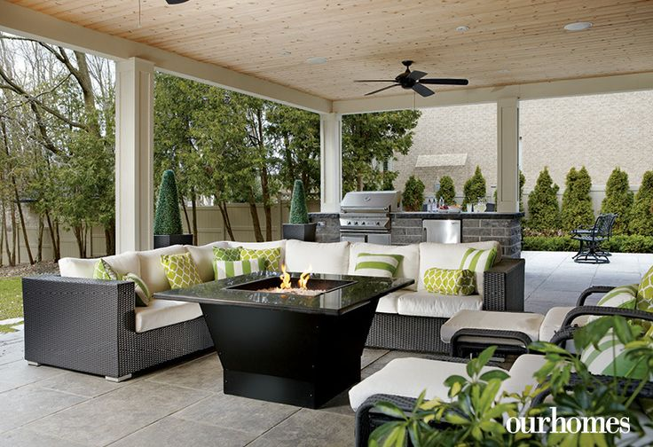 """Perfect for entertaining, a new open-sided covered patio lanai overlooks professionally landscaped grounds and includes a water feature and outdoor kitchen.   See more of this home in """"Lighting Strikes Home in the Hamilton-Area With Crystal"""" from OUR HOMES Hamilton Summer 2016 http://www.ourhomes.ca/articles/build/article/lighting-strikes-home-in-the-hamiltonarea-with-crystal"""