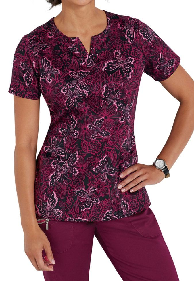 The lovely Butterfly Ballet print dances on this scrub top from Beyond Scrubs, and it's made with all the style and quality you've come to expect from our exclusive brand.