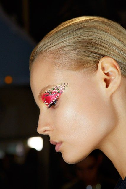 """Runway make-up created by Pat McGarth for Christian Dior Spring/Summer 2013 RTW: """"[We created] a Techno Butterfly look that draws attention to the eyes with intense geometric colours, studded with 'bursts' of Swarovski crystals in matching or constrating shades""""."""