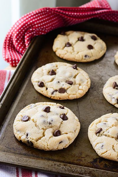 """The MASTER Chocolate Chip Cookie Recipe. Comments say Gold Medal Flour """"extraordinary cc cookie"""" is similar, use large ice cream scoop, 350 for 13 min, just til the shine disappears on top of cookie.  Comment at 5300 ft. said decrease butter to 1 cup, soda to 1 tsp, powder to 1.25 t. Also says add an egg yolk."""