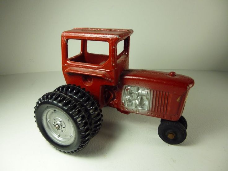 Wonderful Early antique Red toy tractor with double wheels