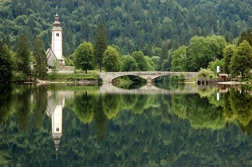 Lake Bohinj with church Triglav National Park Slovenia