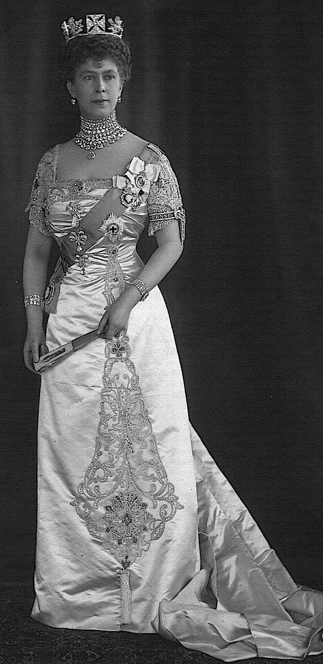 Queen Mary dressed to the nines.  The bodices of her gowns were reinforced with buckram so the heavy diamond brooches didn't distort the fabric.