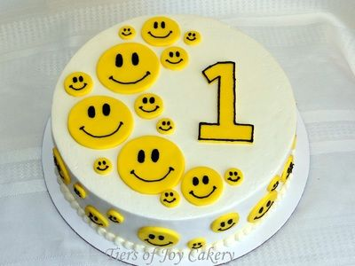 Yellow smiley face cake.