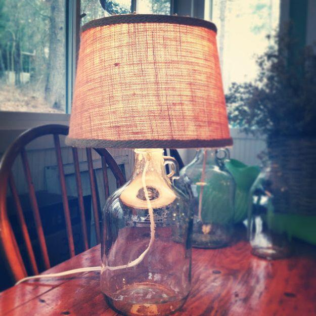 Build a glass bottle lamp. | 21 Pottery Barn-Inspired DIYs