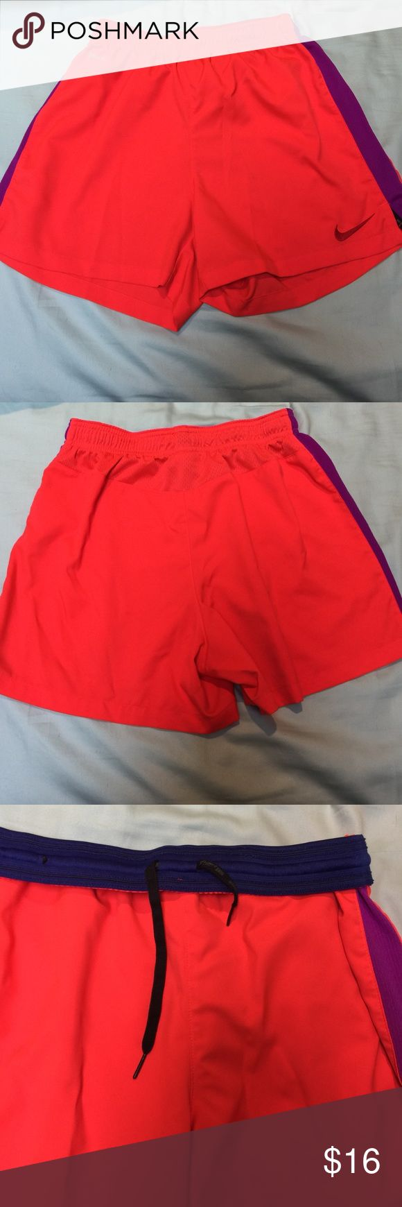 Nike dri fit shorts Size small Nike dri fit shorts 100% poly. Coral color with purple sides. Great condition barely worn Nike Shorts