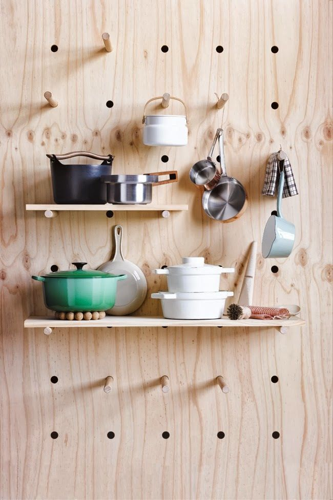 As a lover of both pegboards and Shaker style, I immediately pinned this picture when it popped up in my Pinterest feed. I love the natural, unfinished wood, but how great would it be painted white or even a dark, chalkboard slate gray color?