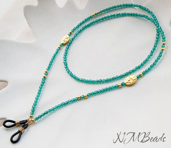 Beaded Emerald Green Crystal Eyeglass Chain Green And Gold Eyeglass Lanyard I designed this eyeglass necklace with emerald green glass faceted crystal beads, gold plated beads and 2 gold plated spacer featuring raised tulip design. For this chain, i used stainless steel beading wire. It has elastic glasses holders with a gold plated coil. Perfect for reading glasses. Simple but chic glasses holder is approximately 28(72cm), lightweight and easy to wear. ♥ All my jewelry comes in a pretty...
