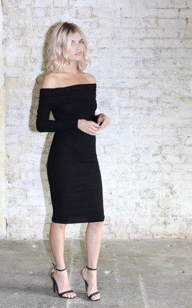 Super fitted rib dress, with sexy neckline balanced out with long sleeves and demure length.