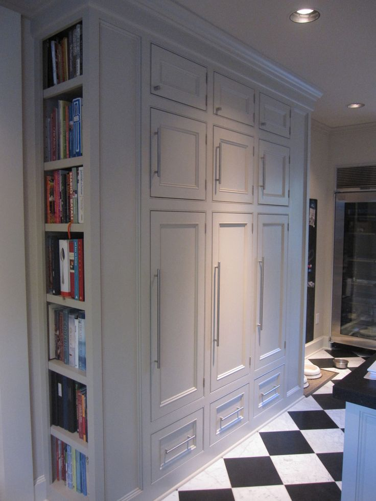 Mudroom Cookbooks In Built In Bookcase On Side Of Lockers