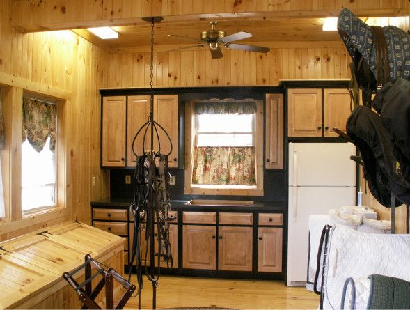 This tack room even includes a kitchen! Built by B&D Builders. www.custombarnbuilding.com