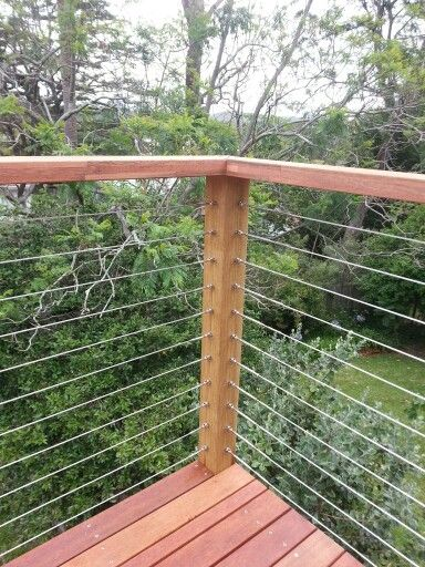 Designed and constructed by Stomp Landscapes. Stainless steel balustrade . hard wood hand rails.