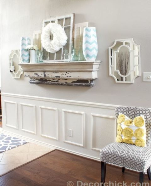 Emily of Decorchick! used a chair rail, wooden frames, caulking, and several coats of white paint to create this wainscoting look-alike. Get the tutorial at Decorchick!.