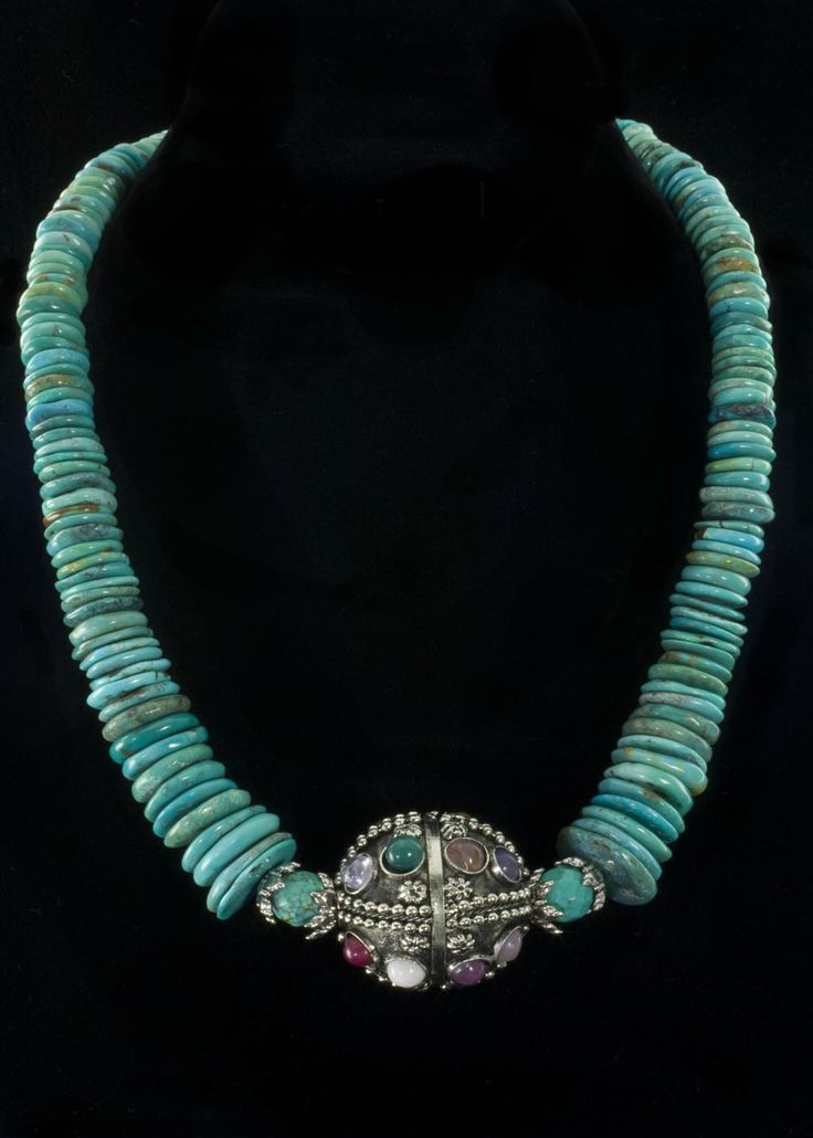 "Turquoise Multi Stone Necklace  Genuine turquoise beads, sterling silver bead caps and adjustable toggle clasp, 18"""". Large Tibetan silver and multi genuine stone large ball center piece.   http://www.sterlingjewelrystores.com/product544.html"