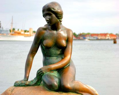 The Little Mermaid in the bay Copenhagen, Denmark. My great grandfather was born in Denmark...gotta go!