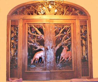 Carved entry doors hand carved custom front entry doors for Amazing hand carved doors