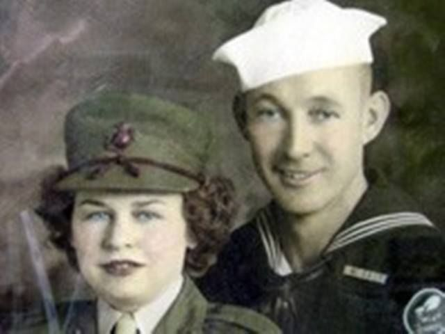 A sailor with his girl, a member of the MCWR (Marine Corps Women's Reserve) ~