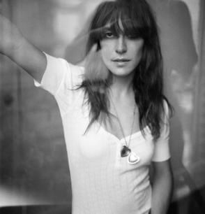 leslie feist -- I love her voice and she turns me on. Feist is one of my fav bands too.