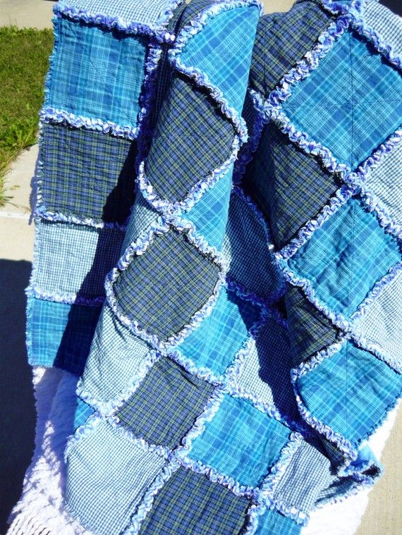 Rag quilt.  I have full intentions of making one of these with flannels for our couch :)  Love the colors on this one, would be great with flannel backing and homespun top like this if I made one like this as well!