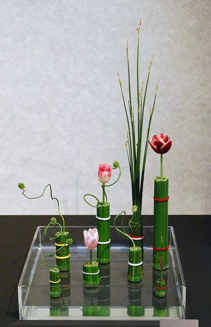 Simple and beautiful.  Only takes a little bamboo and a few stems.  Kyoto Ikebana Exhibition by Mai Wakisaka Photography, via Flickr