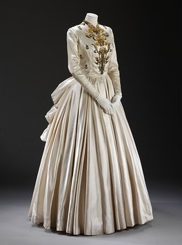 1948, Jacques Fath state dress made of slipper satin embroidered with sequins and beads, Paris. Victoria & Albert Museum, London, UK. Looks very similar to the 1865-75 bustle dresses. (Information from: The Costume Society UK) *prior information removed from pin because of message received. I believe the prior information was talking about the look being similar to the 1865-75 bustle dresses. Orignal pin did not have the additional information that was gathered by The Costume Society UK…