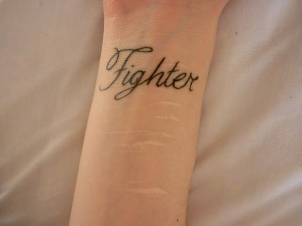 """Fighter"" tattoo over self-harm cuts. Love this idea for people struggling with cutting or those who have already overcome it."