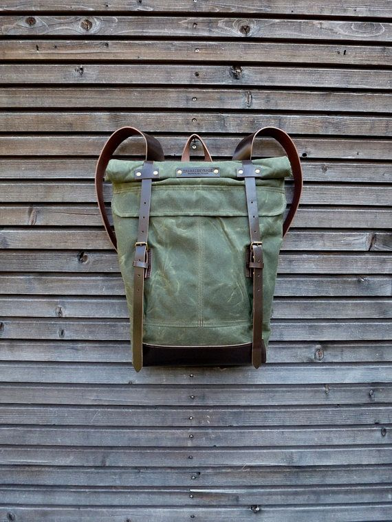 Waxed canvas rucksack / backpack with roll up top and vegetable leather…