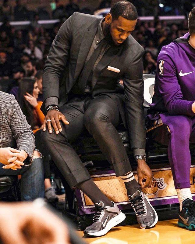 Nike kicks. Feeling his suit