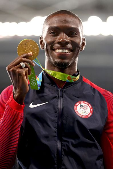 Gold medalist Kerron Clement of the United States poses on the podium during the…