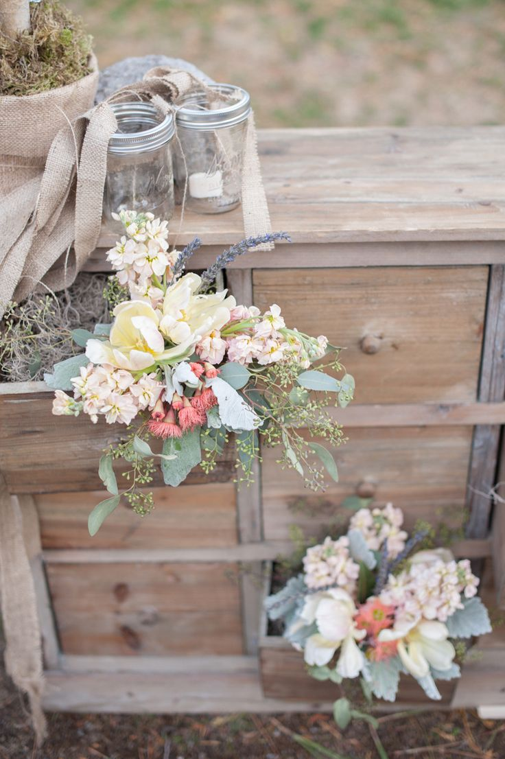 Archive Rentlas Hansford Sideboard piece is the perfect way to join rustic chic and a bit of feminine prettiness with these floral blooms hanging out of the drawers   Read More: http://www.stylemepretty.com/california-weddings/2014/04/21/elegant-outdoor-wedding-in-lake-tahoe/