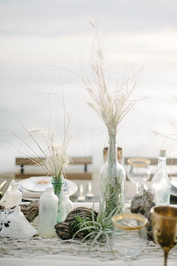 beach wedding centerpieces - photo by John Schnack Photography http://ruffledblog.com/seaside-wedding-inspiration-shoot