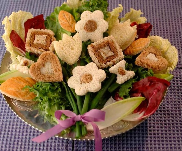 Sandwich Bouquet for a Garden Party, perhaps? Photo only. From the book Tastefully Small Finger Sandwiches: Easy Party Sandwiches for All Occasions Paperback – January 12, 2008 by Kim Hendrickson (Author)