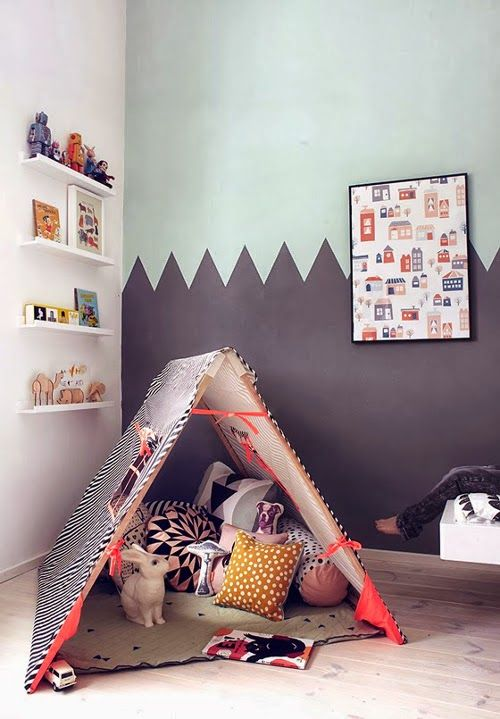 Love how the painted zig zag color blocked wall mimics a mountain range.