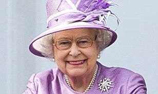 The Queen was all smiles as she watched the Epsom Derby in Surrey yesterday -– back on home soil at last after a demanding State visit to France.