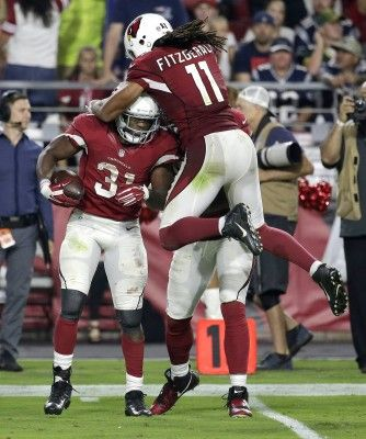 Arizona Cardinals running back David Johnson (31) celebrates his first down run with teammate Larry Fitzgerald during the second half of an NFL football game against the New England Patriots, Sunday, Sept. 11, 2016, in Glendale, Ariz. (AP Photo/Rick Scuteri)