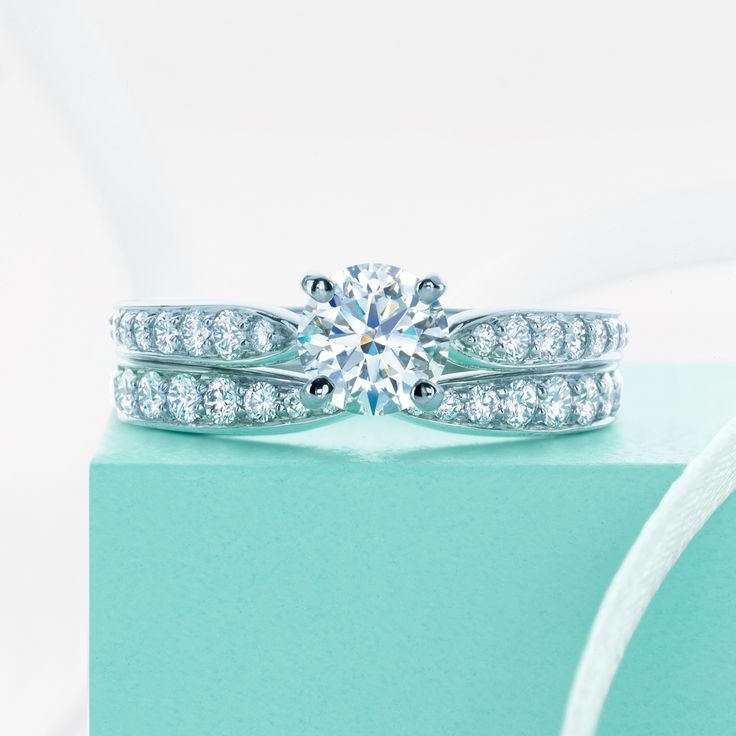 Perfect together. A Tiffany Harmony® diamond engagement ring and matching band.