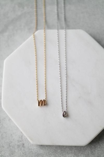 """Delicate chain with a small lowercase script initial. Details - 15.5"""" + 1.25"""" extender - Plated metal - Handmade - Personalized items are made to order, so they can take 1-2 weeks to ship."""