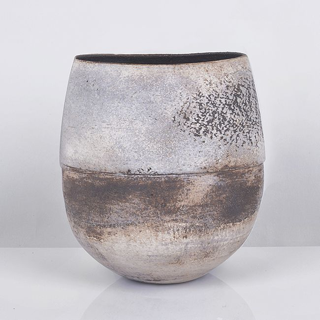 HANS COPER Stoneware, layered white porcelain slips and manganese engobes over a textured body with strong incised line around the body above four symmetrical impressed indents, the interior with manganese glaze, impressed HC seal H 13cm, W 11.5cm, D 10.2cm