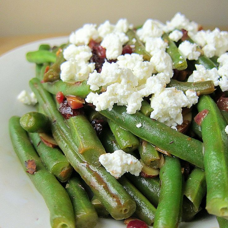 You will never go back to mushy green been casseroles after this side dish of green beans with cranberries, almonds and goat cheese in a fig balsamic glaze.