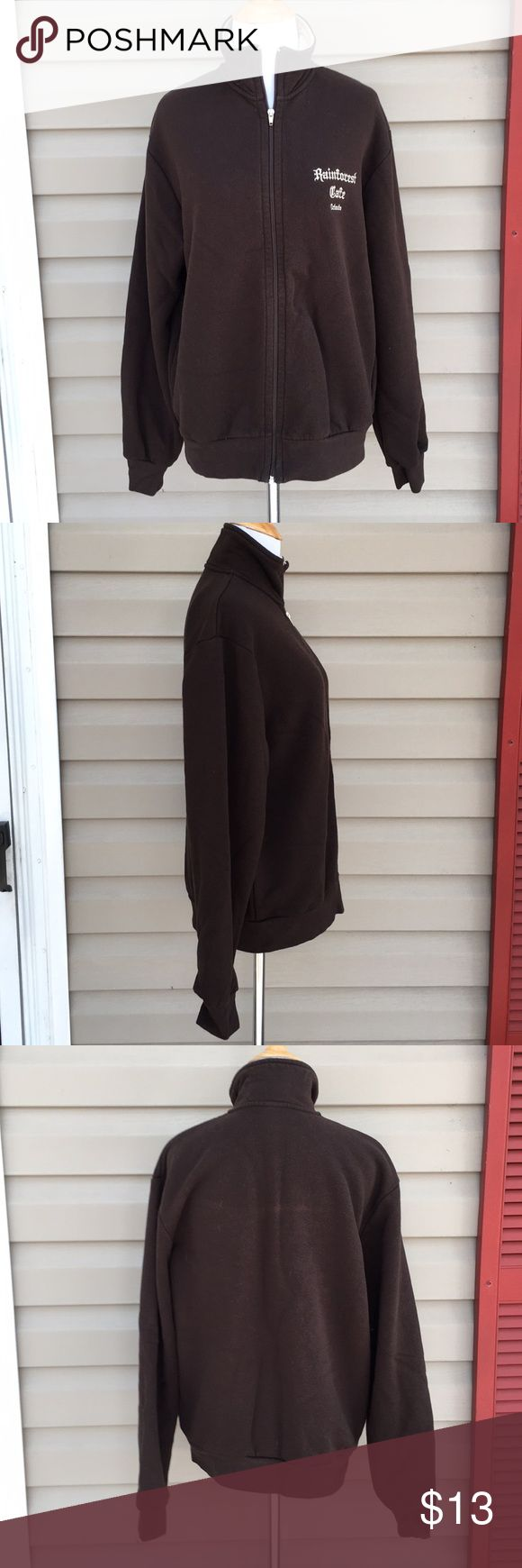 """Rainforest cafe women's brown zip front jacket Like new brown zip front fleece jacket with tan collar, 'Rainforest cafe, Orlando ' on front.80% cotton 20% polyester, no snags, stains, fading or holes. 22""""W x 26""""L Rainforest Cafe Tops Sweatshirts & Hoodies"""