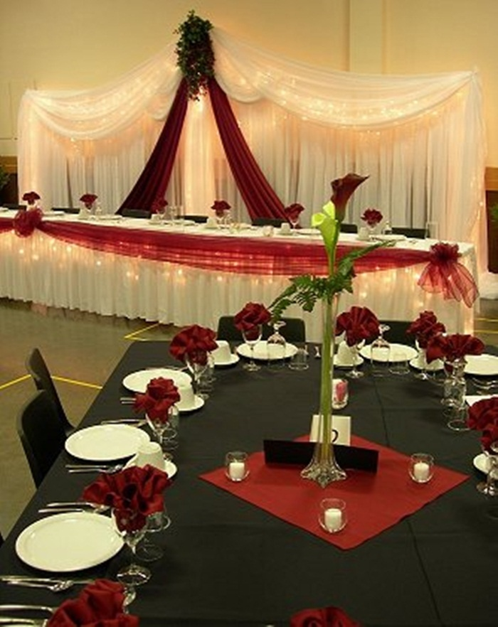 Red & black.............I just told Kelly I wanted black table cloths, red napkins, & white plates & here it is :)