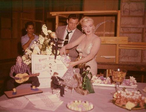 "Marilyn Monroe celebrating her 34th birthday on the set of ""Let's Make Love"" (1960)."