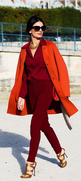 Orange coat over burgundy Lady in Power Dressing. PattyonSite™: