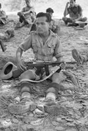 Malaysia, soldier resting with submachine gun during the Malayan Emergency…