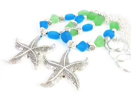 These curtain tiebacks have a center focal starfish and chunky blue and green tumbled sea glass nuggets. These add a beautiful shabby chic beach decor to your home. There is a strong shiny silver chain attached to ends for easy hanging. These are also available with mermaids, as shown in the last photo. These are sure to add the beach and ocean theme to any beach cottage or beach home decor. These starfish curtain tiebacks measure 18 inches from end to end with a silver metal ring for easy…