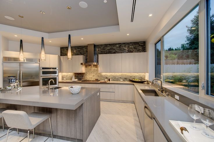 Kitchen with Bellmont Cabinets - Firma, Hardwood floors, Dupont Dove Corian, flush light, European Cabinets, Pendant light