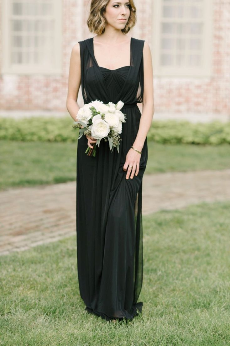 Dressed in all black for a sophisticated ceremony | Convertible long David's Bridal bridesmaid dress