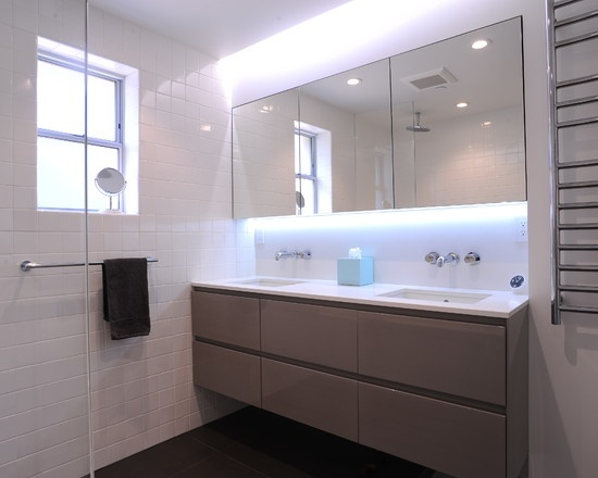 DMC Contemporary bathroom with Ceasarstone tub apron and recessed light valance over custom high gloss lacquer vanity