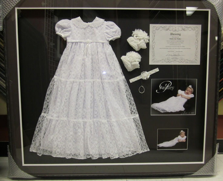 A memory preserved for a lifetime.  Shadow boxed baby blessing dress and other mementos.  Framed by Frameworks of Utah.