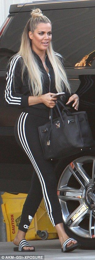 Heading home: The reality star smiled and chatted after another day at the studios for her... KHLOE